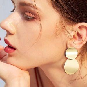 Gold tone wavy disc earrings